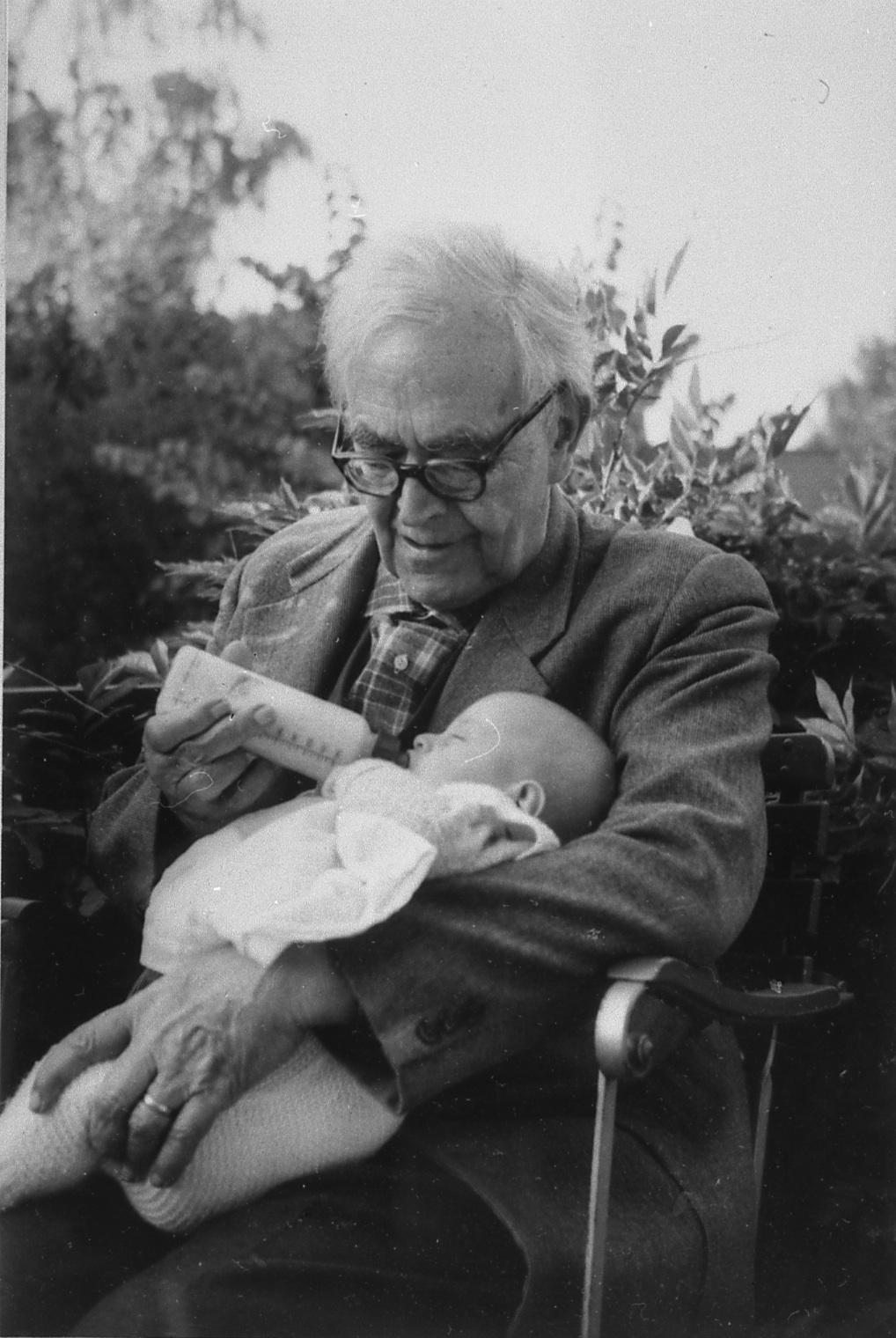 Karl Barth with his first great grandchild, Olivier Schopfer, in 1962.